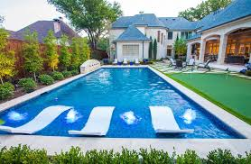 pool layout mediterranean with synthetic turf wood grate