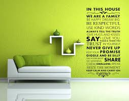 in this house we are a family large size black lettering wall stickers es and saying art wall decor decals for living room bedroom decal wall murals