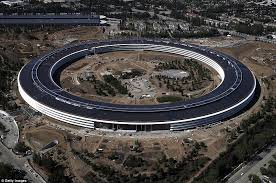 apple office. an aerial view of the new apple headquarters taken on april 28 shows its spaceship office