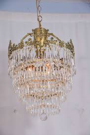 four cascading rows of crystal prisms topped with a delicate cast brass crown total restoration