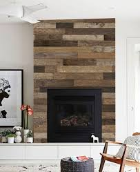 classic interior design with reclaimed wood fireplace surround ideas black stained iron fireplace screen