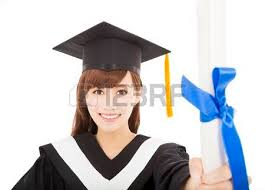 young graduate girl student holding and showing diploma stock  pretty young graduate girl student holding and showing diploma photo