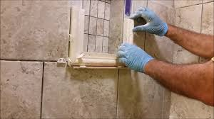 how to install a shower niche frame using traventine chair rail pencil trim