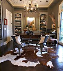 cowhide rug poofing the pillows animal hide rugs home office traditional