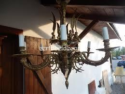 name spanish used bronze chandelier