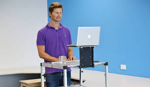 james moore with the first prototype of his standing desk which he will launch in