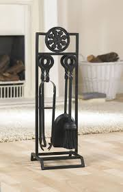 a striking combination of wrought and cast iron together they make the broseley companion set hand made blacksmiths fireside companion set with detailed