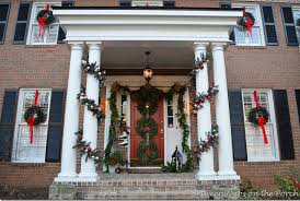 how to hang garland around front doorFront Porch Decorated for Christmas with Three Wreaths on Door and
