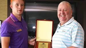Adam Dutson, tournament coordinator, Royal Golf Club (left) congratulates  Steven Hill, the Captains' Day champion