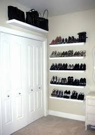 wall mounted shoe storage and white door