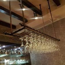 Image result for industrial wine glass hanging rack pub