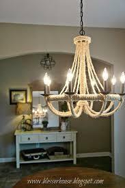 lighting restoration hardware chandelier with wood chest drawer