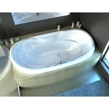 x oval whirlpool jetted bathtub with center drain 60 inch spa escapes center drain corner alcove bathtub