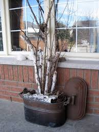 A Pinterest photo shows how birch branches are used in decor.