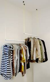clothes hanging bar for closet 13 tricks that squeeze every inch out of a small closet clothes hanging bar