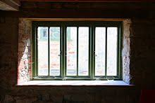Modern wooden framed window fitted in the 14th century Lyme Regis  watermill, UK.