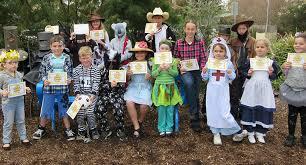 book characters tea gardens students in costumes representing the australian book week theme