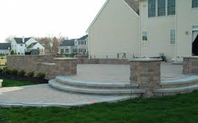 Raised paver patio Build Raised Paver Patio With Outdoor Kitchen Retaining Wall Columns Masonry Contractor Nj Raised Paver Patio With Outdoor Kitchen Retaining Wall Columns