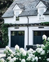 white shiplap exterior black garage doors | architecture and ...