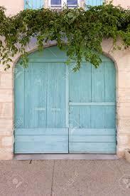painted wood garage door. Contemporary Door Old Wooden Garage Door Rounded Top Painted In Turquoise Surrounded By  Ivy Tendrils With Painted Wood Garage Door