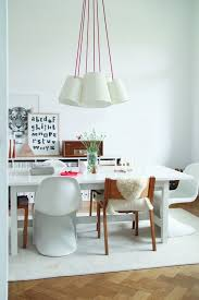 square dining tables tend to work best with square rugs though a round rug could work for a more playful feel