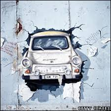 painting of trabant bursting through the berlin wall  on famous berlin wall artists with bbc news europe berlin wall gets fresh lick of paint