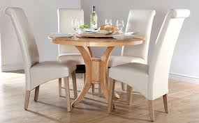 circle dining table set solid wood round dining table for four white leather dining chairs round