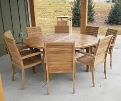 six foot round teak dining table