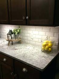 granite countertops rochester ny ice white granite paired with a beveled subway tile and mahogany cabinets