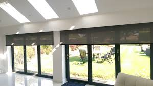 electric roller blinds for byfold doors behind a pelmet