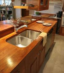 a teak counter in an open plan kitchen