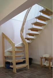Deluxe Wooden Modern Staircase With Simple Iron Pipe Banister As Well As  White Wall Painted As Small Space Interior Levels Home Designs