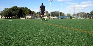 Artificial turf soccer field Synthetic Soccer Player Playing On Soccer Pitch At Dowdy Field In Hollywood Florida Featuring Sportsgrass By Bostoncom Dowdy Field Soccer Field In Hollywood Fl Foreverlawn Inc