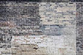 old multi colored brick wall mural is printed on removable wallpaper sold by aboutmurals