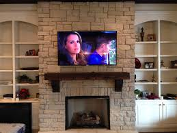 how to hang tv above brick fireplace and hide wires image