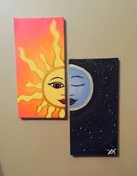 Sun and moon matching canvas paintings.