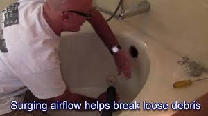 how to clear a bathtub drain with a vac