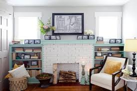 white painted fireplace with mint green bookshelves