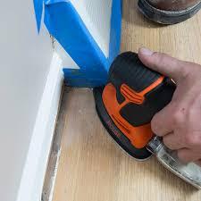 detail sander refinishing hardwoods in a corner