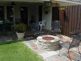 Exterior:Backyard With Outdoor Dining Set And Metal Chairs Surrounding A Fire  Pit Backyard With