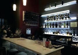 hanging glass rack for bar restaurant wine wall display at citizen bistro racks medium size wood