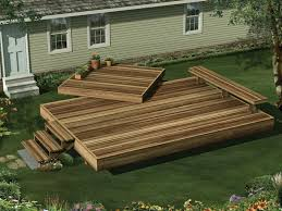 this two level garden deck includes a built in bench on one side