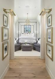 cool hallway lighting. pine wood floors separated shiplap hallway walls accented with gold leaf framed black and white photography cool lighting