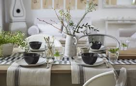 a neutral coloured table setting with cotton napkins simple place settings and a natural