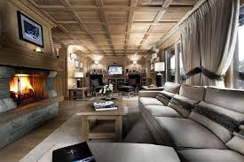 brown modern chalet design with stunning alpine views large living room with fireplace in the