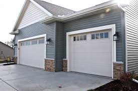 carriage style garage doors in almond and madison window inserts