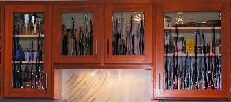 kitchen storage cabinet made of cherry wood using glass door with seaweed motif full