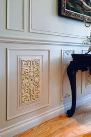 You've decorated your living room with wainscoting, chair rails, and wall  panels