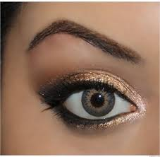 gold eyeshadow sin on the inner corner of the eye half baked on the inner half of the lid right next to that use smog then dark horse then add creep to