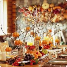 For easy fall's arrangements grab a bunch of vases, stuff dried twigs in  them and
